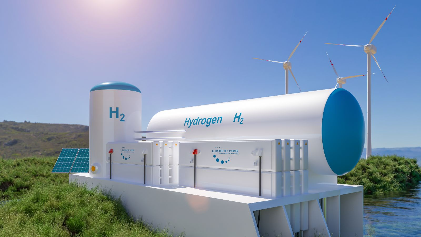 Das Bild zeigt einen Elektrolyseur neben einem Windrad an einer Küste.
